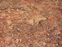 Old rusty crumbled tin can stock image